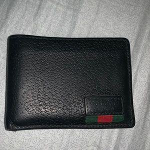 76d720e59170 AUTHENTIC Gucci Men's bi-fold wallet